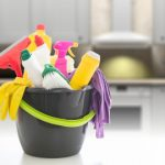 Be Clean bucket full of cleaning products